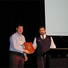 ASI Chairman Mark Vassella (left) presents the 2003 National Site Safety Excellence Award to BlueScope Steel Lysaght Archerfield Operations Manager Steve Sargeant.